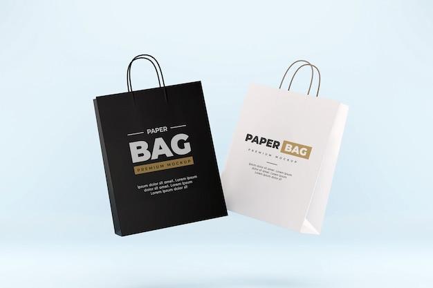 Maquette de sac en papier flottant shopping réaliste noir et blanc
