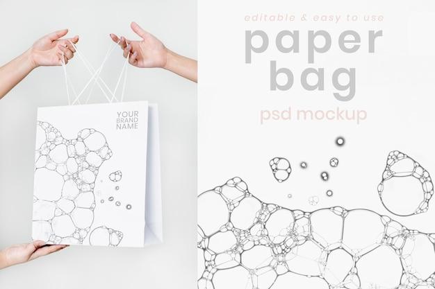 Maquette de sac à provisions en papier psd avec impression d'art à bulles créatives