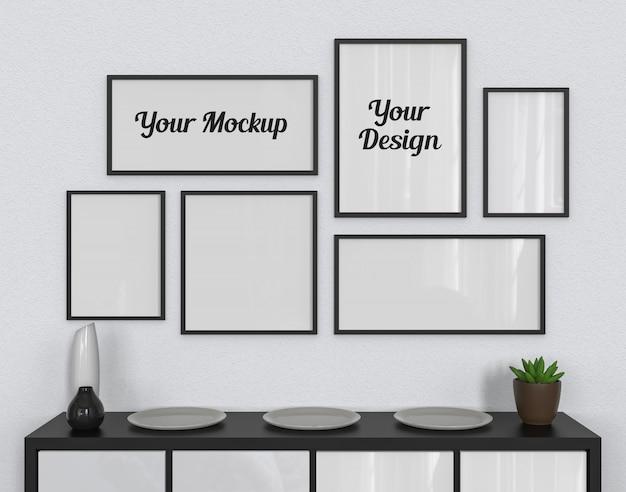 Maquette de six cadres photo accrochée au mur blanc