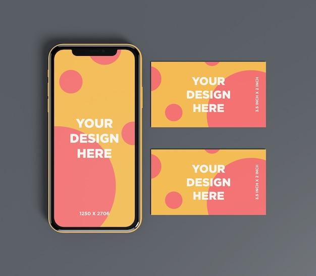 Maquette de smartphone avec double vue de dessus de carte de visite
