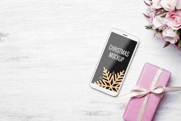 Maquette de smartphone pour la décoration de noël et du nouvel an