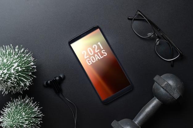 Maquette de smartphone pour les résolutions du nouvel an ou les objectifs d'un mode de vie sain
