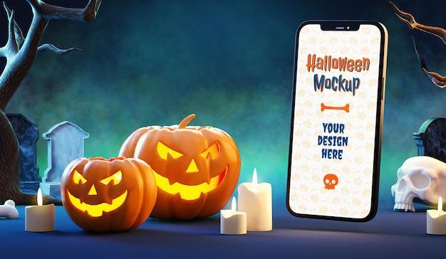 Maquette de téléphone portable d'halloween dans une scène nocturne mystérieuse avec des citrouilles et du brouillard