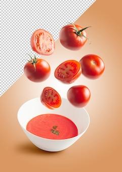 Maquette de tomate tombant dans un bol avec de la crème de tomate