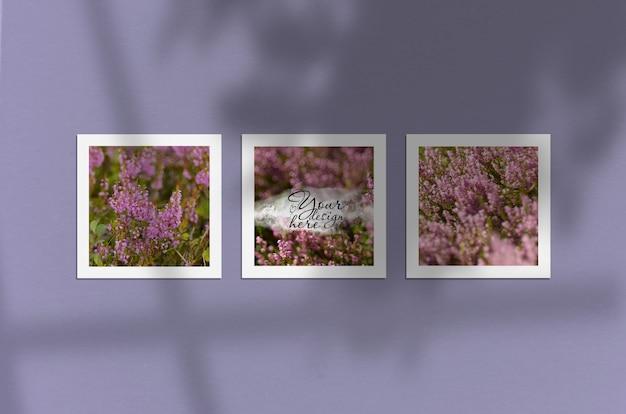 Maquette de trois affiches sur un mur violet avec des ombres de fenêtre et d'arbre