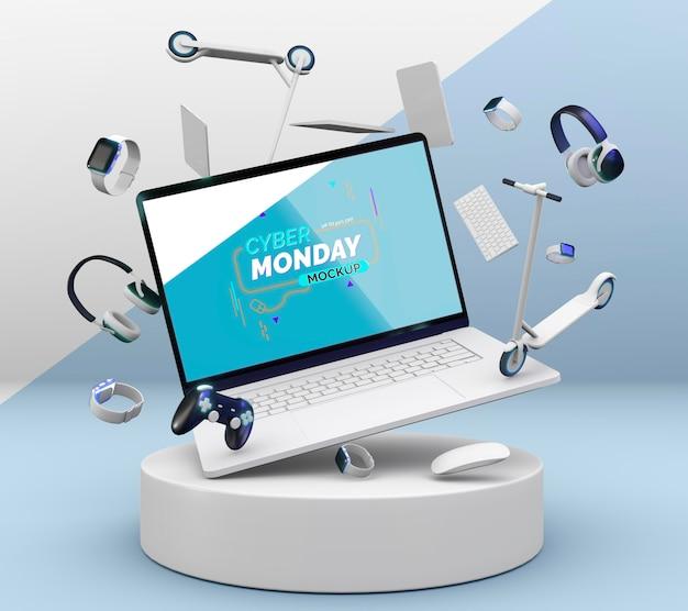 Maquette de vente d'ordinateur portable cyber monday avec assortiment de différents appareils