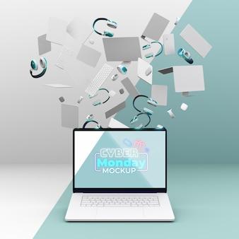Maquette de vente d'ordinateurs portables cyber monday avec assortiment d'appareils