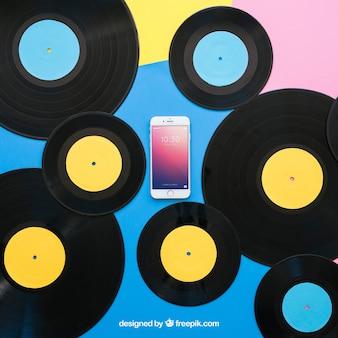 Maquette de vinyle avec smartphone