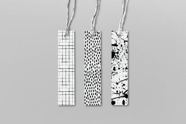 Maquettes d'étiquettes de vêtements psd avec motif de pinceau d'encre