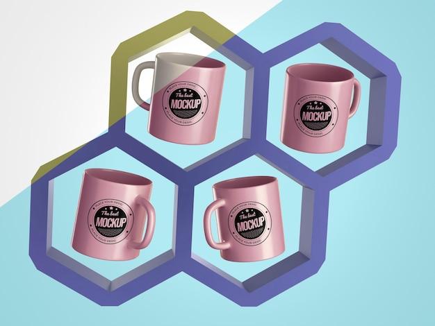 Marchandises de tasses de maquette abstraites dans des hexagones
