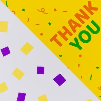 Merci avec des confettis et des formes géométriques abstraites