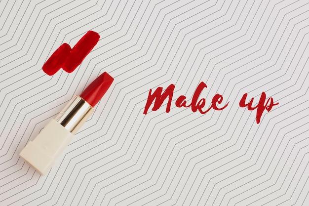 Mise à plat de maquette de concept de maquillage de rouge à lèvres