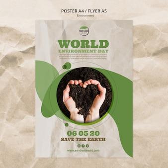 Modèle d'affiche de la journée mondiale de l'environnement avec du sol en forme de coeur