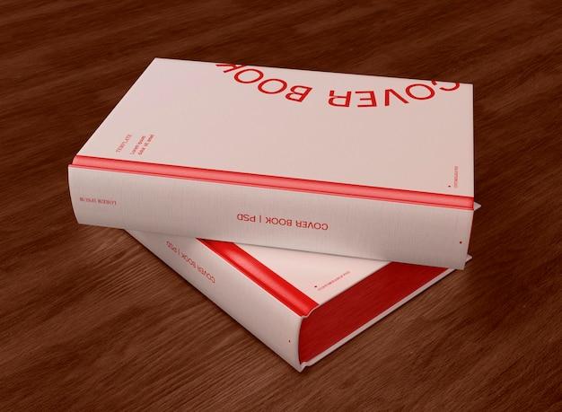 Modèle de couvertures de deux livres 3d sur bakground en bois
