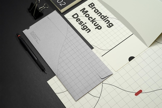 Modèle de maquette de marque de papeterie avec un crayon pour cahier d'enveloppe de carte de visite a4 en-tête rouge