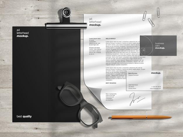 Modèle de maquette de papeterie d'identité d'entreprise professionnelle et créateur de scène avec papier à en-tête et cartes de visite