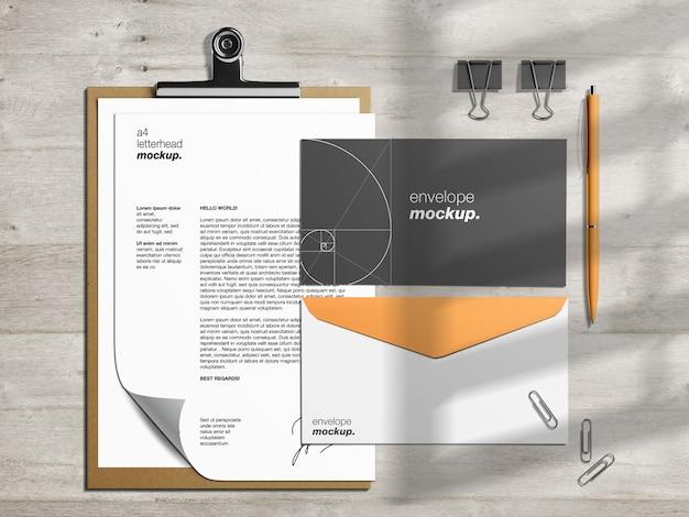 Modèle de maquette de papeterie d'identité d'entreprise professionnelle et créateur de scène avec papier à en-tête et enveloppes de trombone