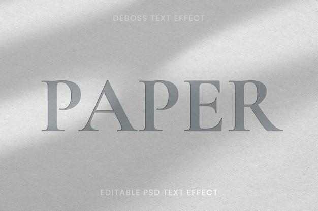 Modèle modifiable d'effet de texte en creux psd sur fond de texture de papier