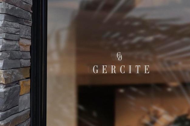 Mur de pierre de signe de fenêtre de maquette de logo