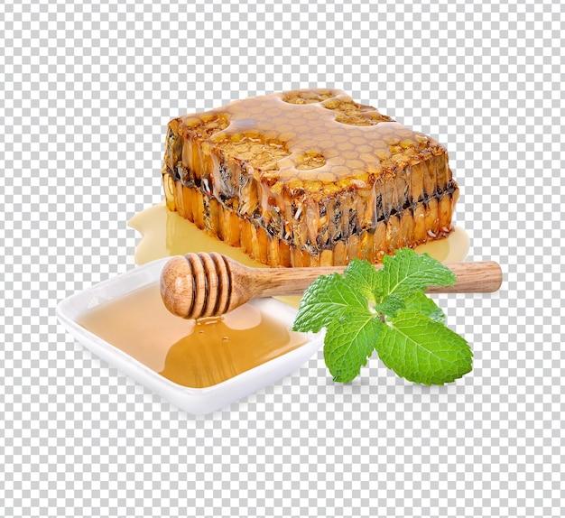 Nid d'abeille avec des feuilles de menthe isolées psd premium