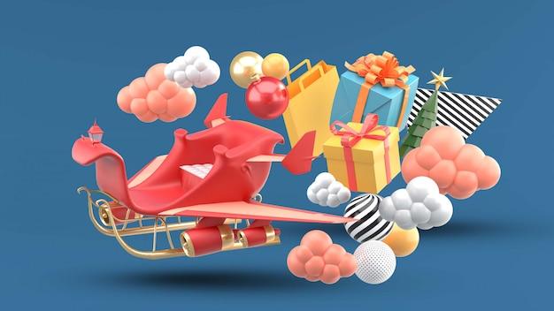 Noël en traîneau avec des ailes flottant parmi les coffrets cadeaux