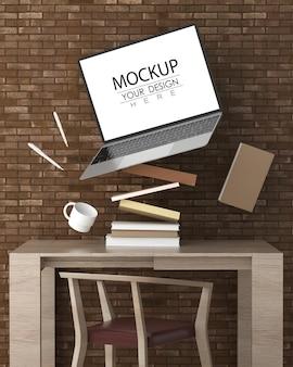 Ordinateur portable sur le bureau dans la maquette psd de l'espace de travail