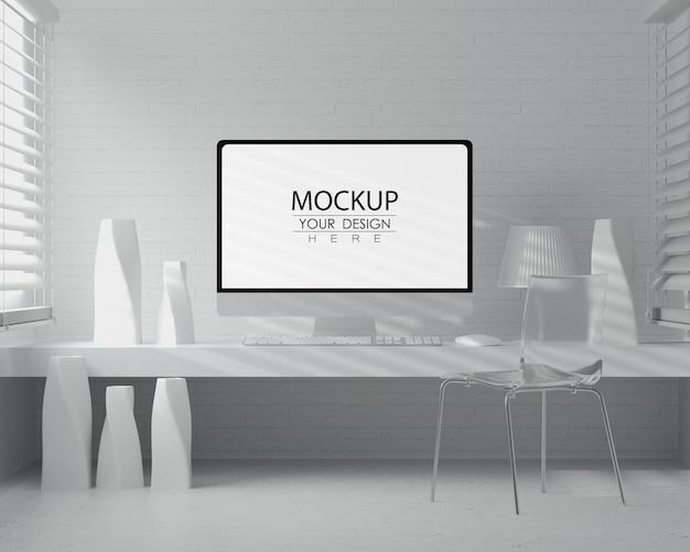 Ordinateur sur table dans la maquette de l'espace de travail