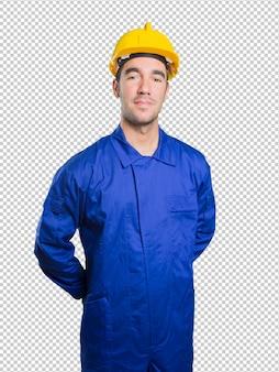 Ouvrier confiant sur fond blanc