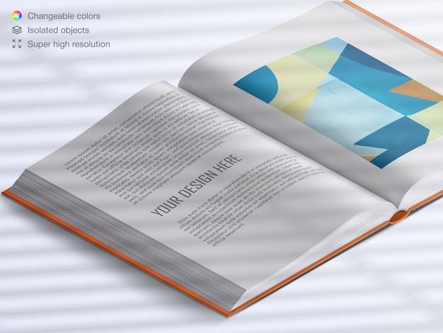 Pages de livre ouvertes réalistes à angle élevé avec maquette de superposition d'ombre