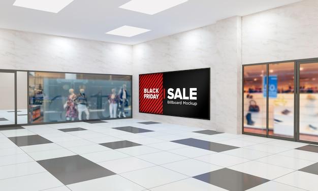 Panneau d'affichage sur maquette murale dans le centre commercial avec bannière de vente black friday