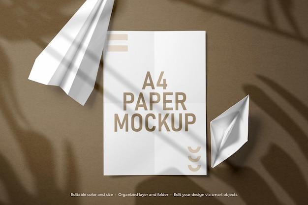 Papier a4 plié et maquette d'enveloppe de papeterie de marque