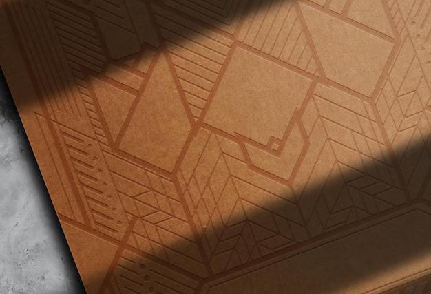 Papier brun de luxe gros plan vue prospective du papier de la maquette du logo en relief