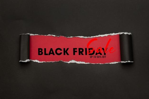 Papier déchiré noir et maquette de vente vendredi noir texte pour votre conception