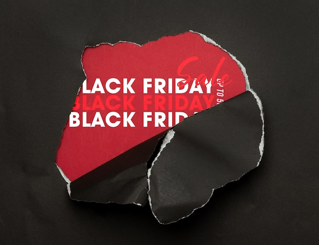 Papier déchiré noir et maquette de vente vendredi noir texte