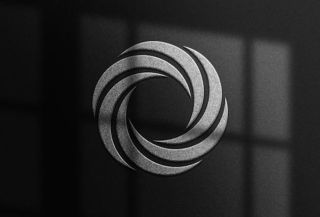 Papier noir avec logo en relief argenté réaliste