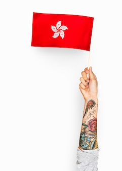 Personne agitant le drapeau de hong kong