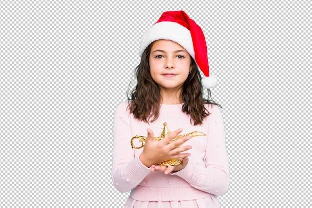 Petite fille demandant un désir célébrant le jour de noël