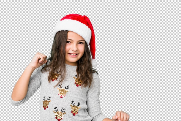Petite fille fête le jour de noël danser et s'amuser.