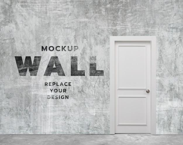 Pièce minimale de mur en béton et maquette de porte