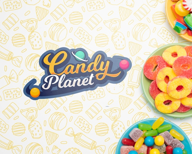 Planète de bonbons et assiettes remplies de bonbons