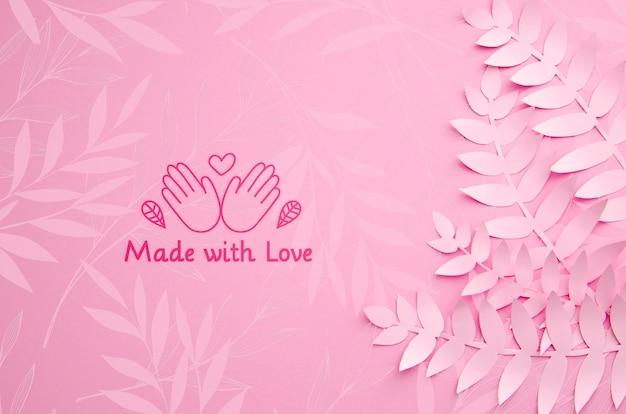 Plante de papier rose monochrome fond de feuilles