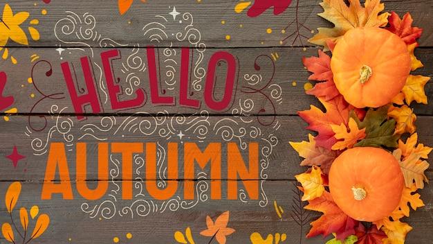 Plat lay bonjour automne avec citrouille et feuilles