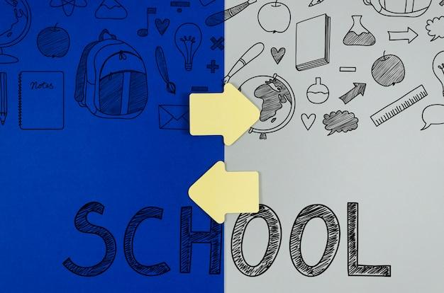 Plat lay retour à l'école avec fond coloré