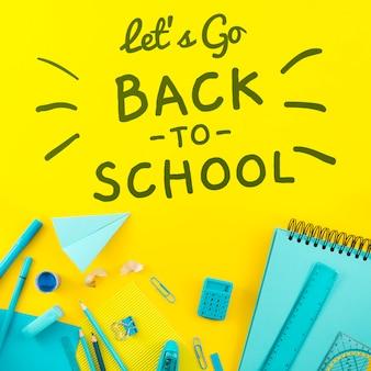 Plat lay retour à l'école avec fond jaune