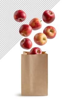 Pommes volantes dans un sac en papier recyclable isolé