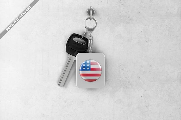 Porte-clés rectangulaire en plastique avec une clé accrochée à un crochet