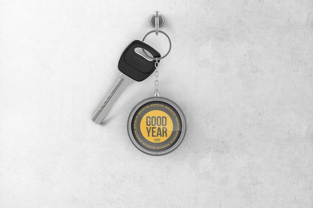 Porte-clés rond en métal avec une clé accrochée à un crochet