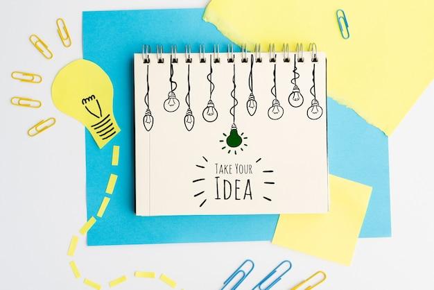 Prenez votre idée doodle avec vue de dessus ampoules