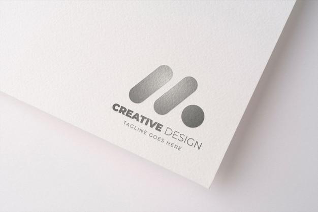 Présentation du logo sur la texture du papier
