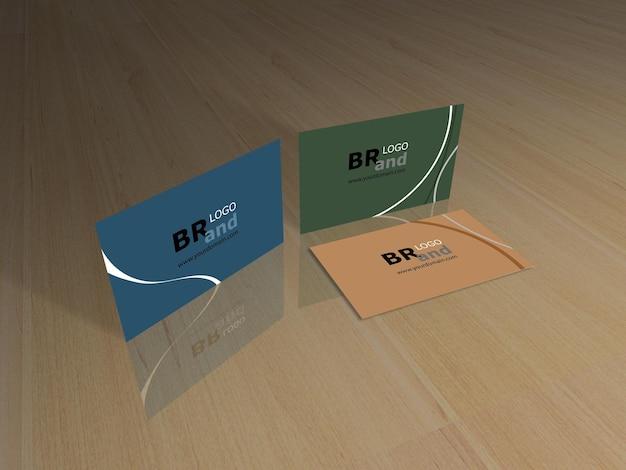 Rendu 3d de cartes de visite sur plancher en bois. maquette